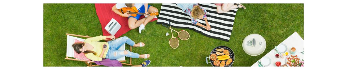 Overhead photo of a picnic with people on lawn chairs and blankets