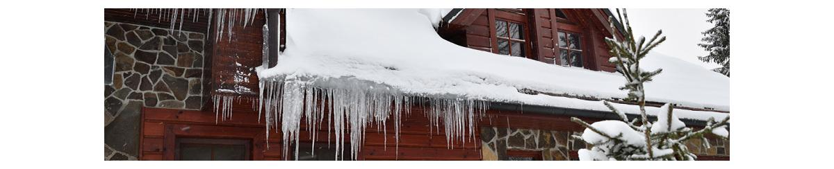 Snow and ice hanging over roof gutter