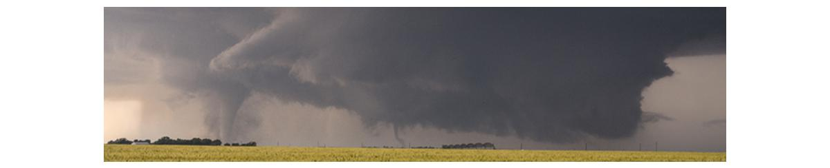 Tornado touching down in a field