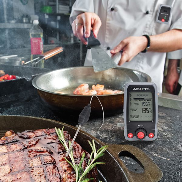 Digital Meat Thermometer & Timer with Pager measuring the temperature of beef - AcuRite Kitchen Gadgets
