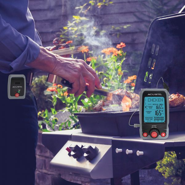 Digital Meat Thermometer & Timer with Pager by a grill - AcuRite Kitchen Gadgets