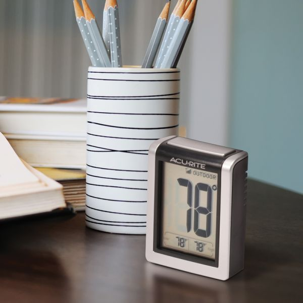 Indoor and Outdoor Temperature Monitor on a desk - Acurite Weather Monitoring Devices