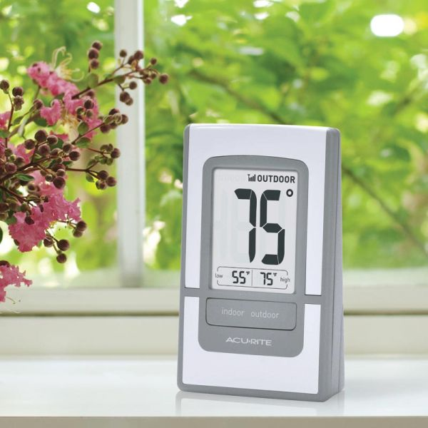 4.5-Inch Silver Digital Outdoor Thermometer sitting next to a window - AcuRite Weather Monitoring Devices