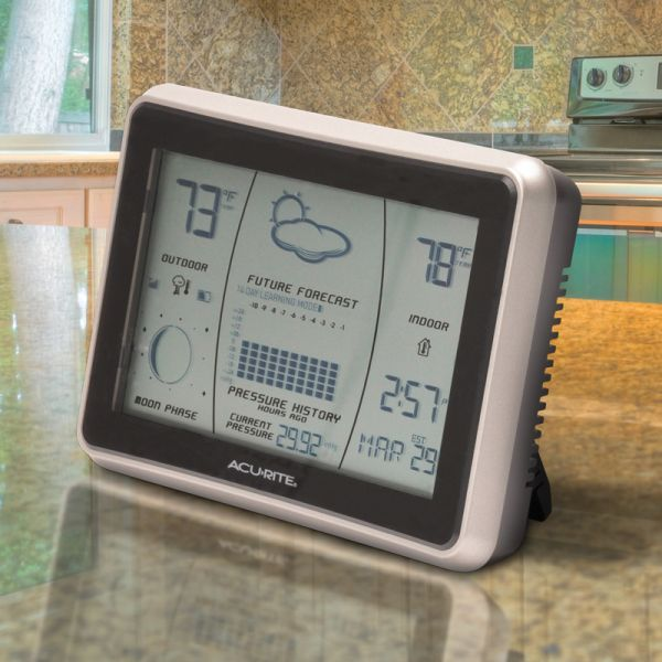 Wireless Weather Station with Forecast Display sitting on a counter - AcuRite Weather Monitoring Devices