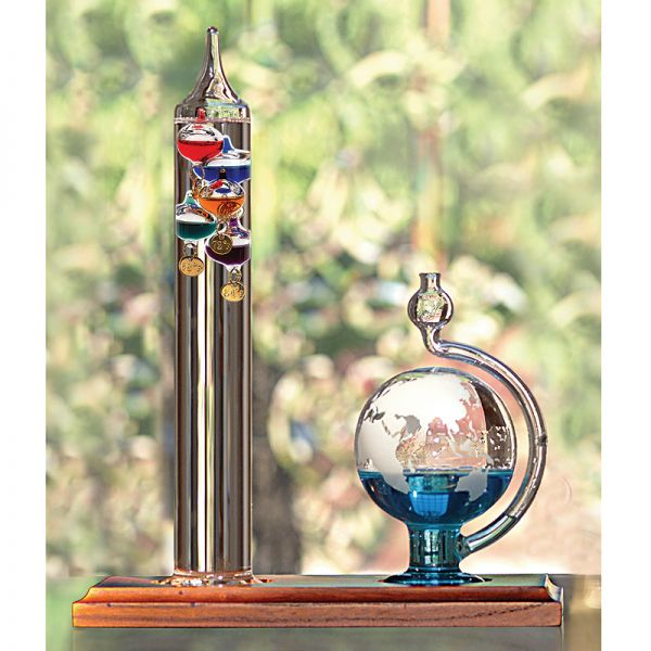 Glass Galileo Thermometer with Globe Storm Glass used on a desk -  AcuRite Weather Monitoring Devices