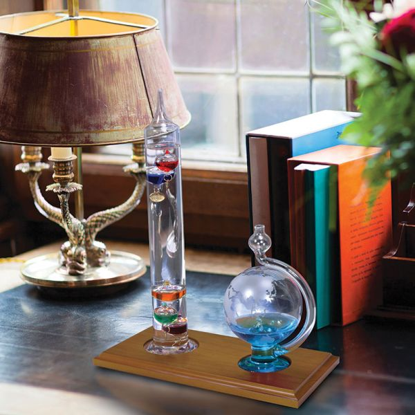 Glass Galileo Thermometer with Globe Storm Glass used in an office - AcuRite Weather Monitoring Devices