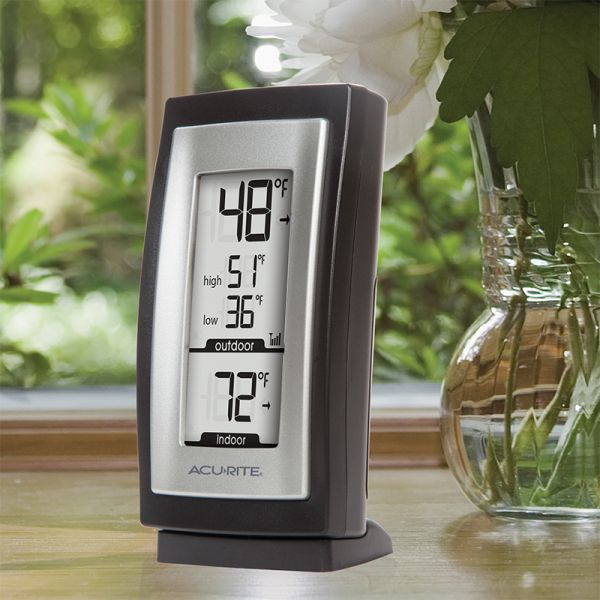 Digital Thermometer with Outdoor Temperature sitting on a table - AcuRite Weather Monitoring Devices
