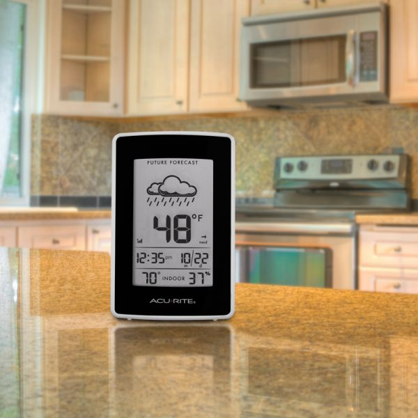 Weather Station display sitting on a kitchen counter - AcuRite Weather Monitoring Devices