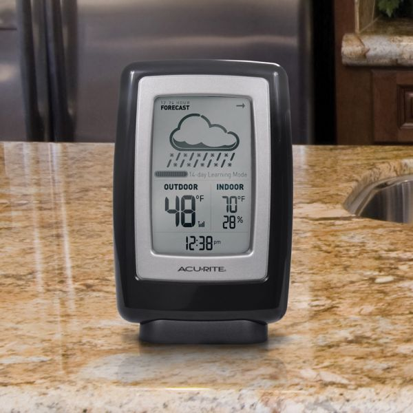 6 Inch Digital Weather Station with Forecast Display sitting on a counter - AcuRite Weather Monitoring Devices