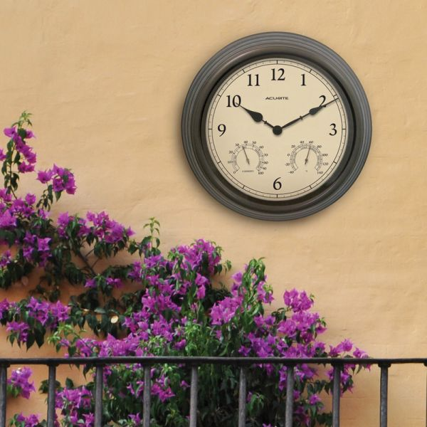 15-inch Weathered Bronze Outdoor Clock with Thermometer and Humidity hanging on an outside wall - AcuRite Clocks
