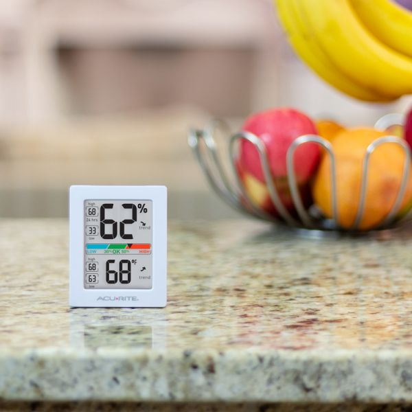 AcuRite Pro Accuracy Indoor Temperature and Humidity Monitor sitting on a kitchen counter - AcuRite Home Monitoring Devices