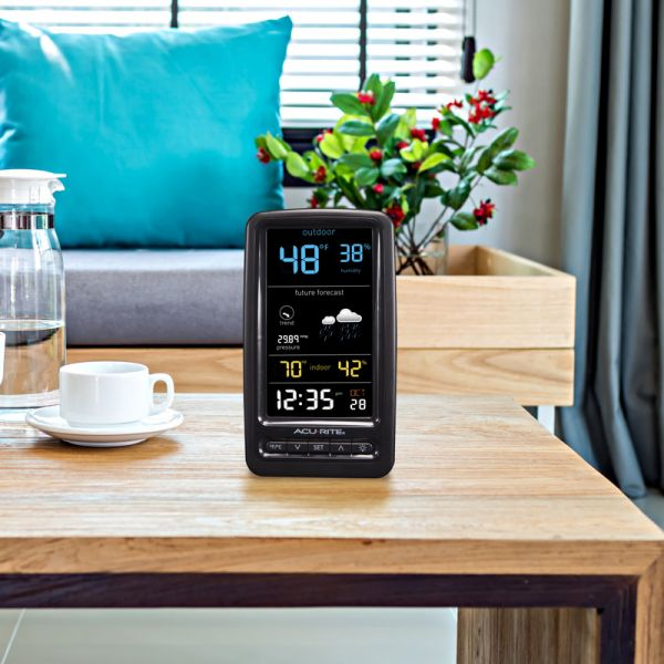 Digital Weather Station Display sitting on a table  - AcuRite Weather Monitoring Devices