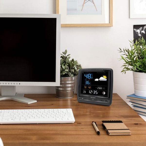 Home Weather Station Display sitting on a desk - AcuRite Weather Monitoring Devices