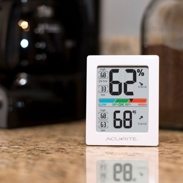 AcuRite Pro Accuracy Indoor Temperature and Humidity Monitor sitting on a mantle - AcuRite Home Monitoring Devices