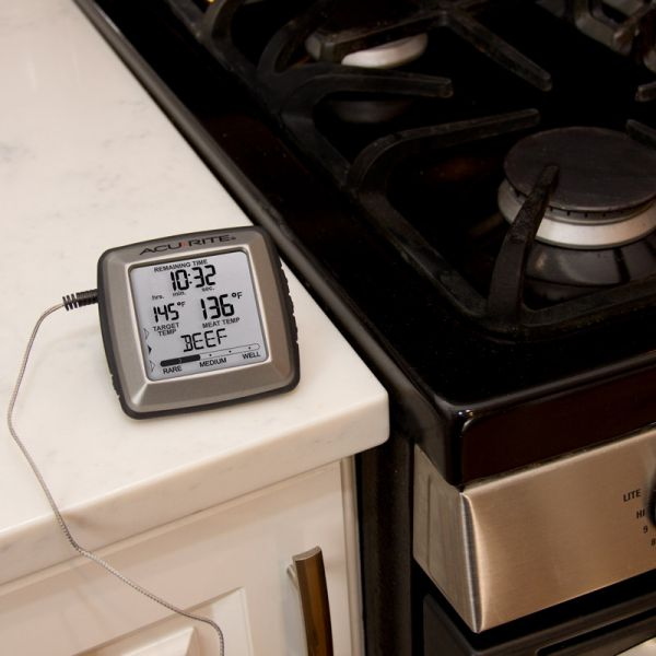 Digital Meat thermometer by a stove - AcuRite Kitchen Gadgets