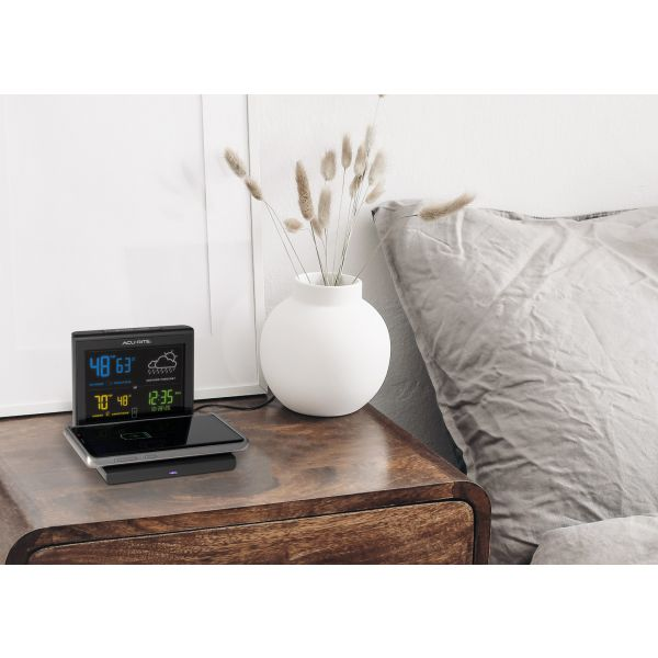 weather forecaster with wireless charger life style view