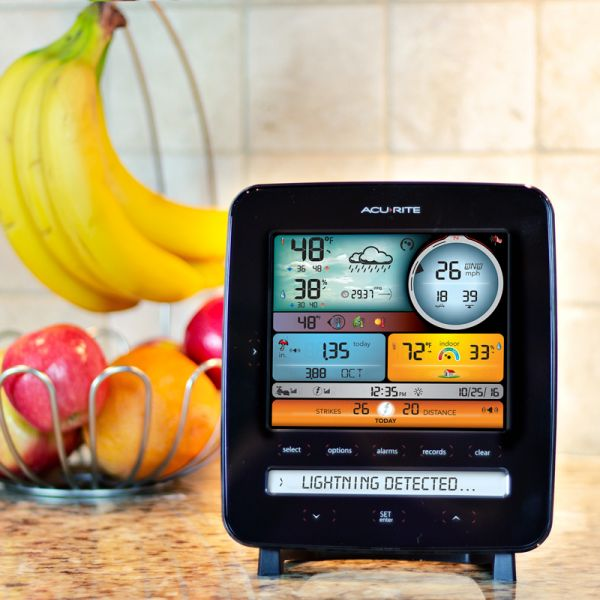 Color Display for 5-in-1 Weather Stations with Lightning Detection sitting on a kitchen counter - AcuRite Weather Monitoring Devices