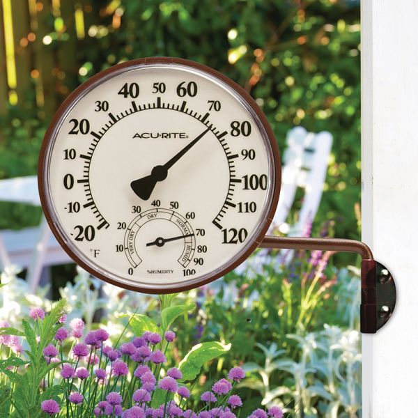 3.5-inch Bronze Swivel Thermometer with Humidity attached to the side of a house - AcuRite Weather Monitoring Devices