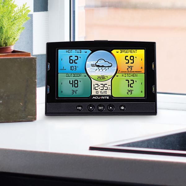 Weather Station with Forecast Display sitting on a counter - AcuRite Weather Monitoring Devices