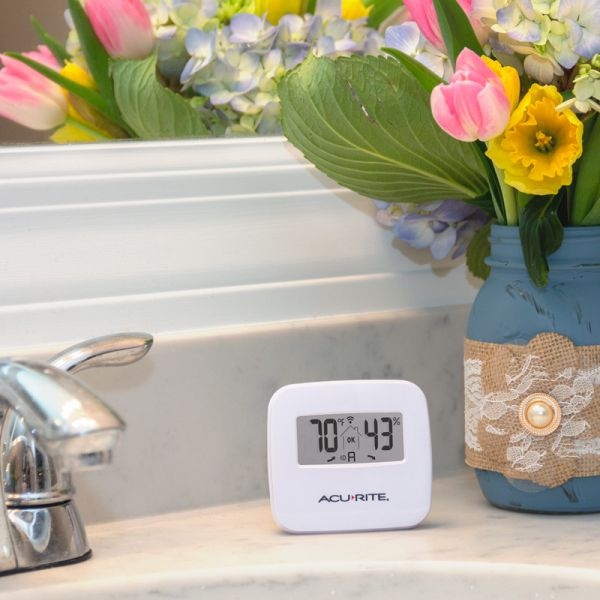 Indoor Temperature and Humidity Sensor sitting on a counter - AcuRite Home Monitoring Devices