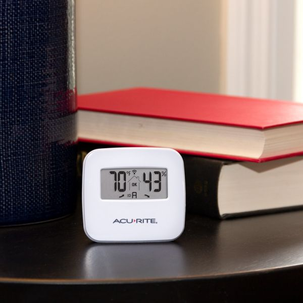 Indoor Temperature and Humidity Sensor sitting on a table - AcuRite Home Monitoring Devices