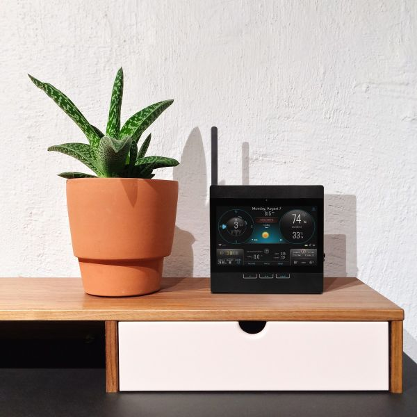 AcuRite Atlas Wi-Fi Display - Lifestyle view with plant