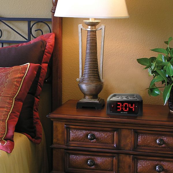 AcuRite Inteli-Time loud alarm clock sitting on a bedside table