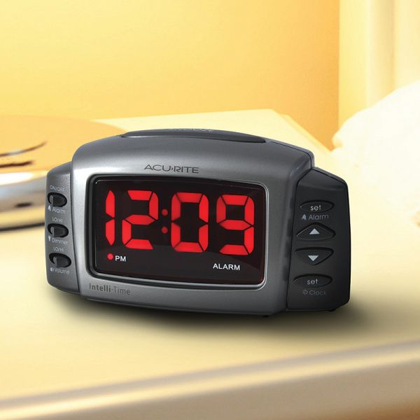AcuRite Intelli-Time digital alarm clock sitting on a bedroom end table