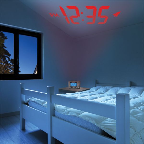 AcuRite atomic projection alarm clock in a bedroom at night