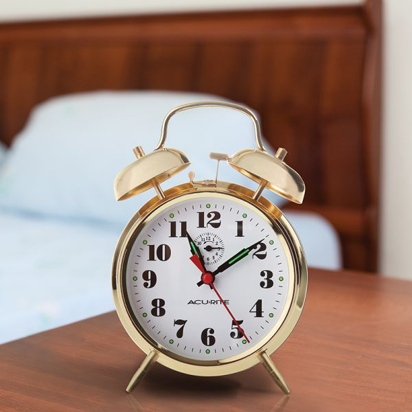 AcuRite vintage metal twin bell alarm clock sitting on a bedside table