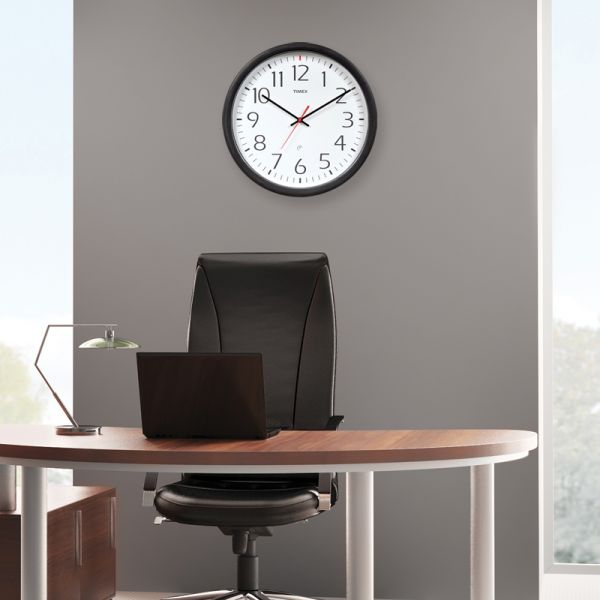 AcuRite Set & Forget Timex wall clock hanging in an office