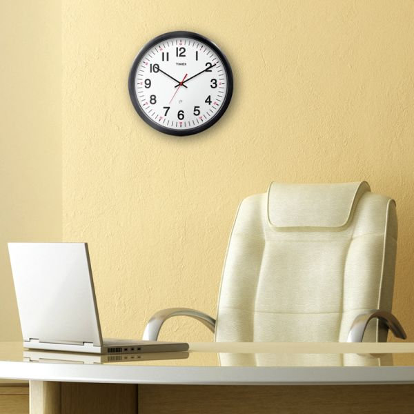AcuRite Set & Forget Timex clock hanging in an office