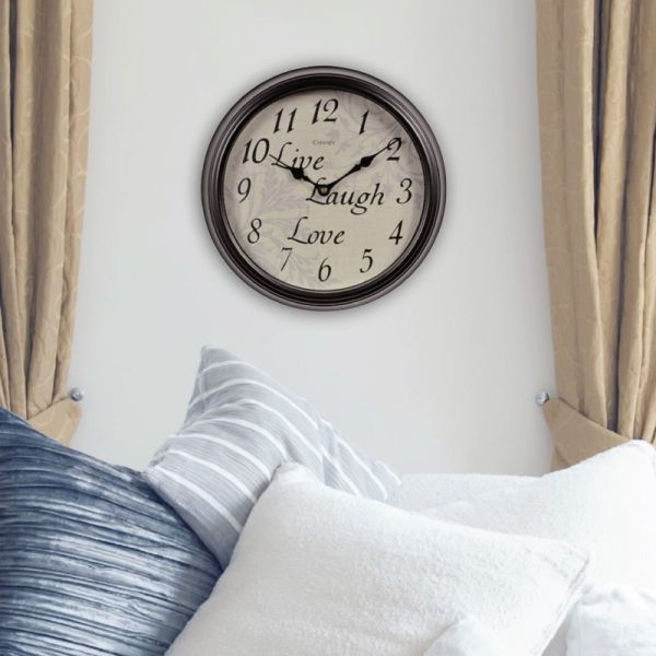 12-inch Live Laugh Love Wall Clock hanging on a wall - AcuRite Clocks