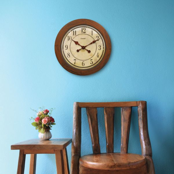 16-inch Wood Wall Clock hanging on a blue wall - AcuRite Clocks