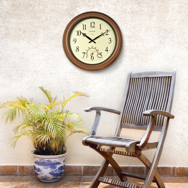 AcuRite outdoor clock hanging on front porch