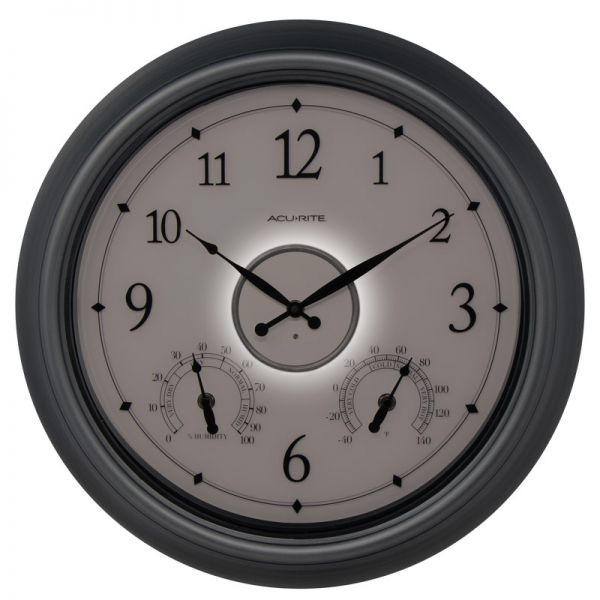 AcuRite 18-inch pewter illuminated LED outdoor clock with temperature and humidity lit up at night