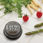 Stainless Steel Rotary Digital Timer on a kitchen counter - AcuRite Kitchen