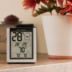 Indoor Temperature and Humidity Monitor sitting on a counter - AcuRite  Home Monitoring Devices