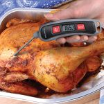 Digital Instant Read Thermometer with Folding Probe used while cooking chicken - AcuRite Kitchen Gadgets