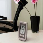 Digital Thermometer with Outdoor Temperature sitting on a desk - AcuRite Weather Monitoring Devices