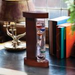 Glass Galileo Thermometer with Wood Stand on a desk - AcuRite Thermometers