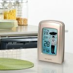 5 Inch What-to-Wear Digital Weather Station Display sitting on a counter - AcuRite Weather Monitoring Devices