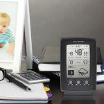 Digital Weather Station with Forecast Display sitting on a desk - AcuRite Weather Monitoring Devices