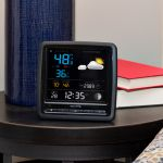Home Weather Station Display sitting on an end table - AcuRite Weather Monitoring Devices