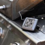 Digital Meat thermometer by a grill - AcuRite Kitchen Gadgets