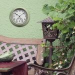 AcuRite green clock hanging on a wall outside