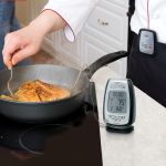 Digital Meat Thermometer & Timer with Pager being used in the kitchen - AcuRite Kitchen Gadgets