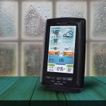Display for Weather Station with Rain Gauge and Lightning Detector Near a Window – AcuRite Weather Tools