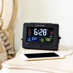 Atomic Clock with USB Charger & Dual Alarm on a bedside table - AcuRite Clocks