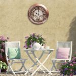 18-inch Copper Metal Outdoor Clock hanging outside - AcuRite Clocks